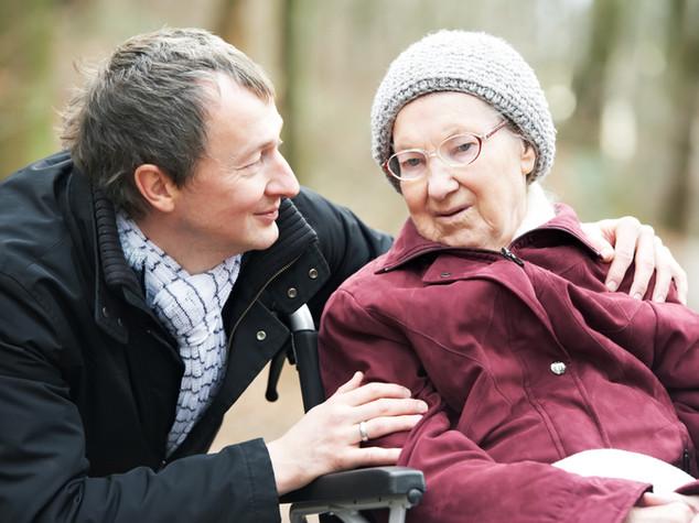 Man with Elderly woman in Wheelchair