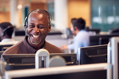 Image of black male customer services laughing