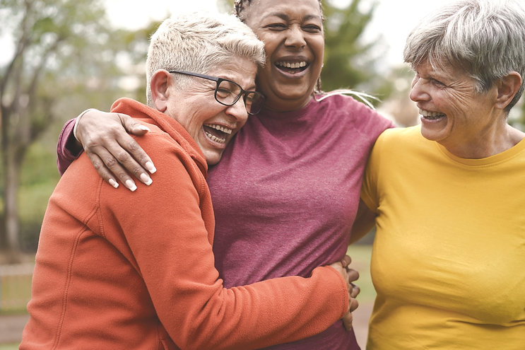 Group of women hugging and laughing