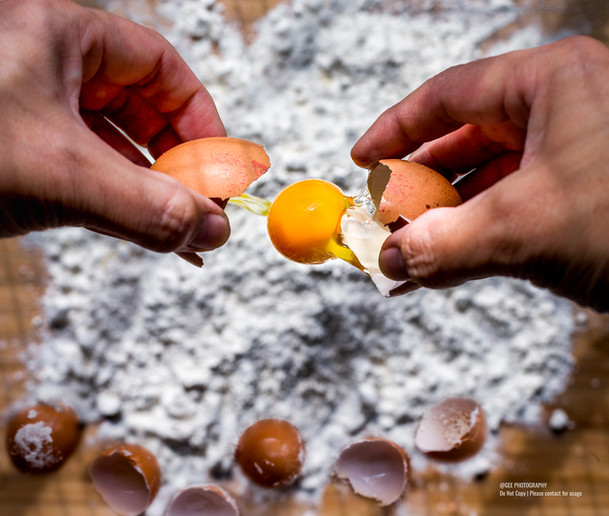 Egg cracking dough making food photography by Gee Photography