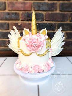 Flying unicorn cake with chocolate wings