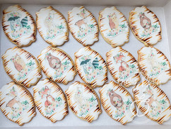 Woodlands themed royal iced biscuits