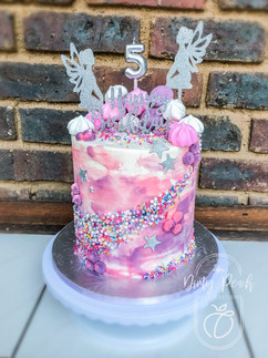 Textured Buttercream fairy cake with sprinkles and Lazer-cut topper