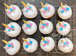 Unicorn themed baby shower doughnuts