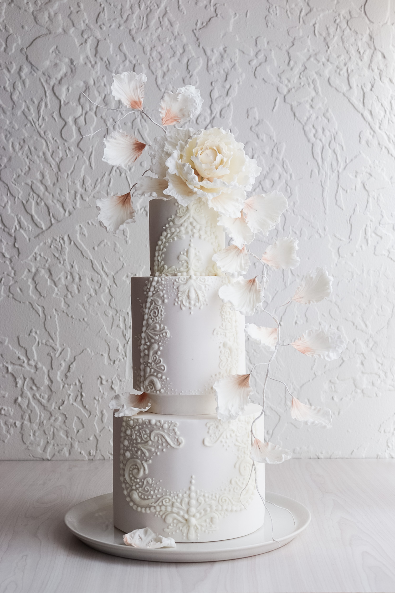 White Wedding cake with hand piping