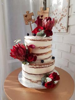 Naked wedding cake with fresh flowers.jp