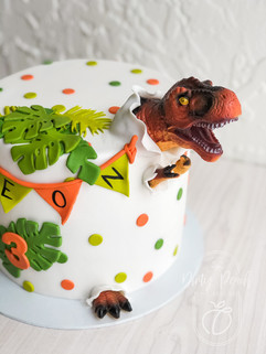 Dinosaur eating cake
