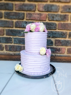 2 Tier buttercream cake with fresh flowers