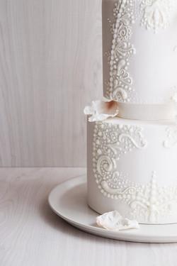 White wedding cake- hand piping
