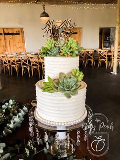 2 Tier buttercream wedding cake with suc