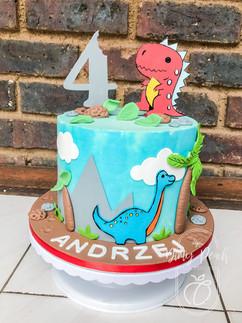 Cartoon dinosaur themed cake with flat fondant figurines