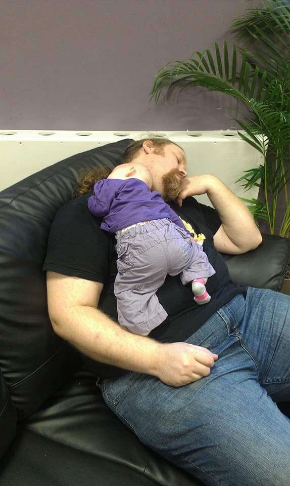 Sleeping father and baby