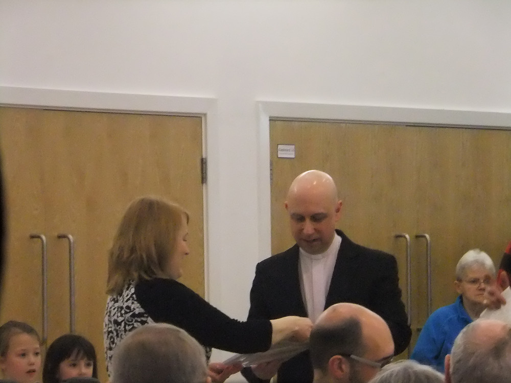 Rev's Gary and Helen Hodgson being presented with leaving gifts