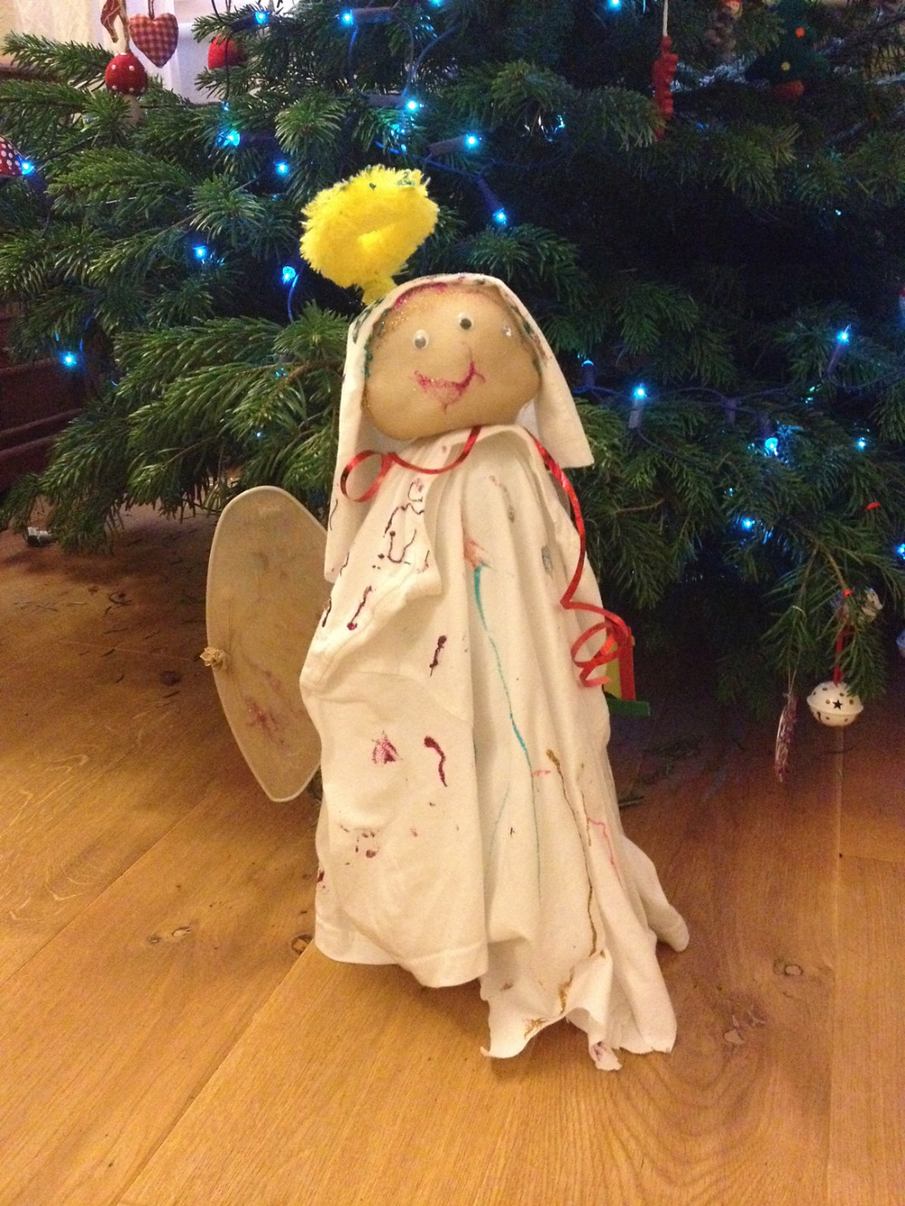 Homemade Angel under a Christmas Tree