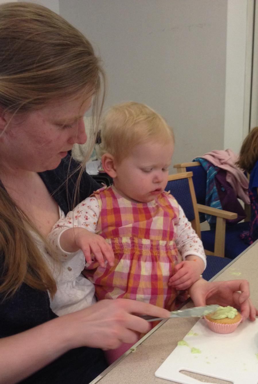 Mum and toddler icing bun