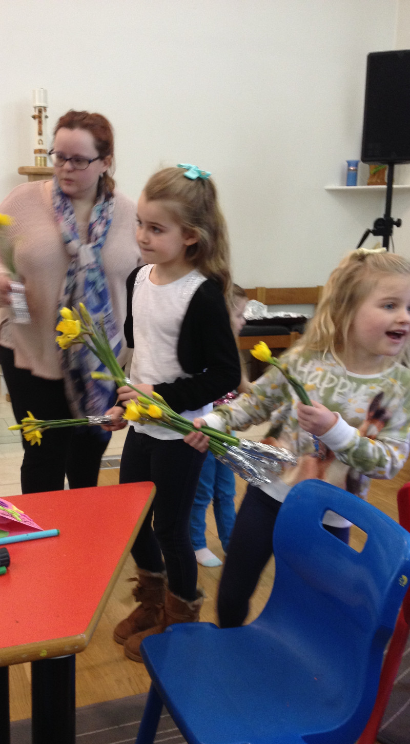 Children distributing the flowers for mothers day