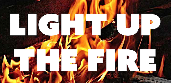 Light up the fire written over picture of flames
