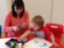 Mum and child doing craftts together