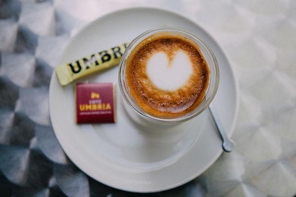 Macchiato with a heart design in the foam sittin on a white saucer at Café Umbria in Seattle, Washington