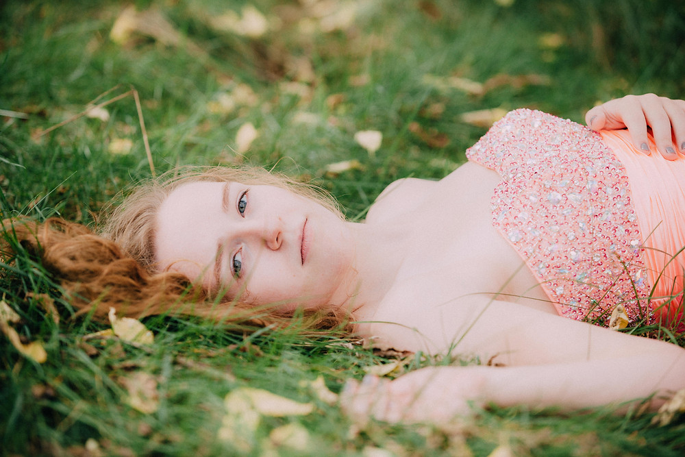 Young woman laying in the grass