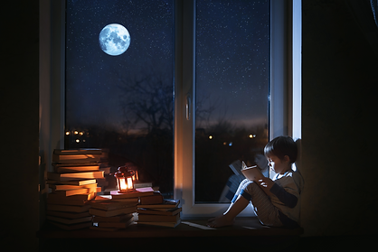 BOY BY WINDOW MOON READING BOOKS.png