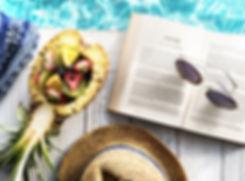 reading beach pool food hat glasses book