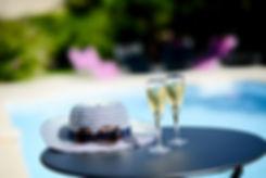 champagne pool hat sunglasses good.jpg
