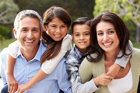 Portrait Of Hispanic Family In Countrysi