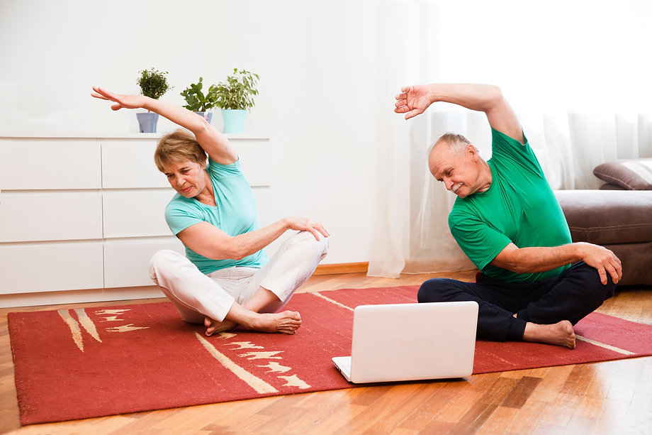 active senior couple doing stretching ex