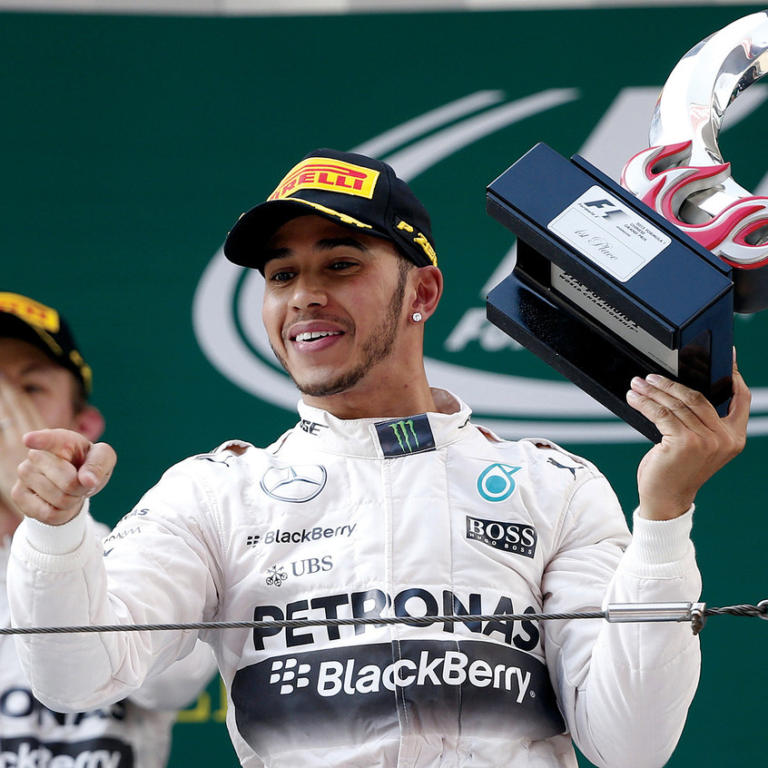 f1MexicanGPmercedes-formula-one-driver-lewis-hamilton-of-britain-r-gestures-with-his-trophy-as-he-celebrates-his-victory-after-winning-the-recent-chinese-f1-grand-prix-at-the-shanghai-international-circuit