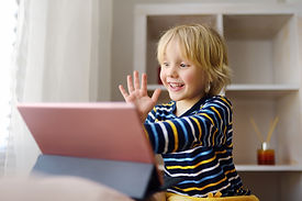 boy excited on ipad.jpg