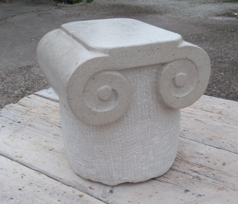 Ionic capital stone carving