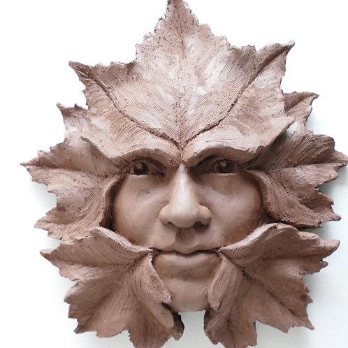 Green man clay sculpture