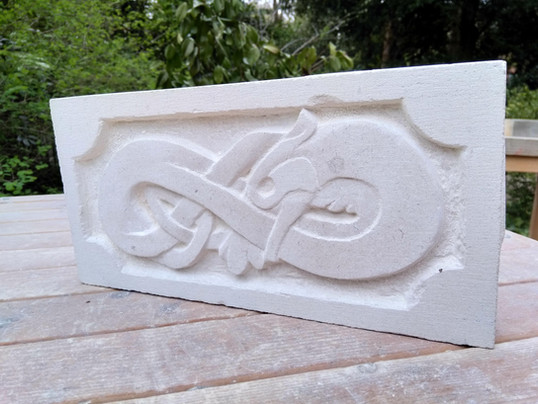 Celtic dragon relief stone carving