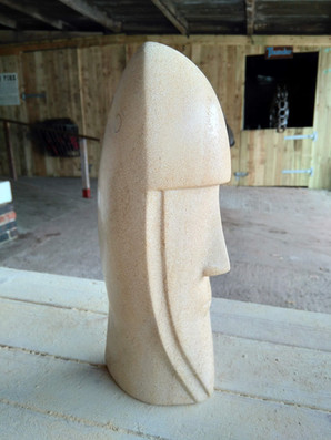 abstract helmet head stone carving