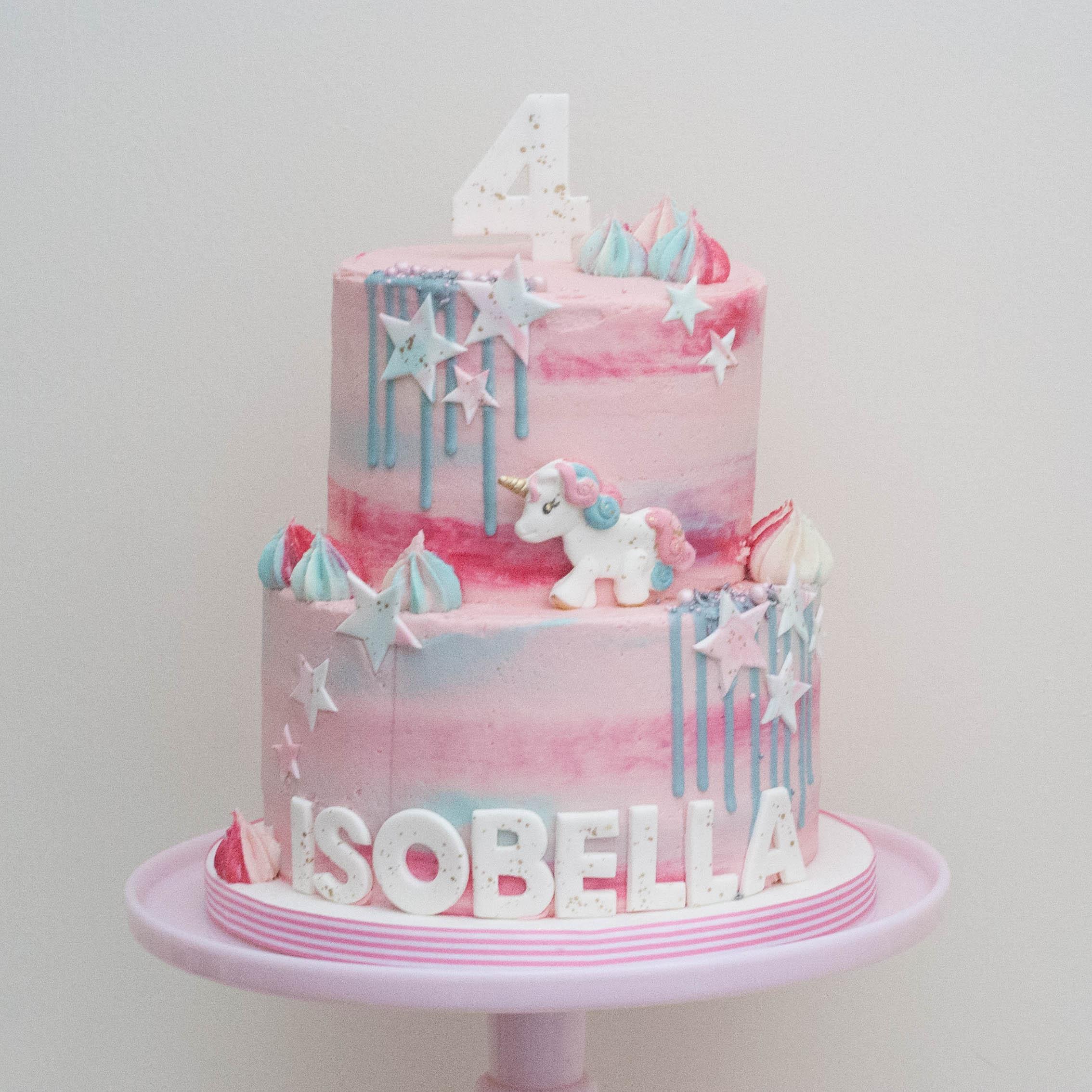 pink two tier watercolour vegan cake unicorn