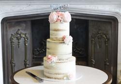 three tier semi naked wedding cake pink sugar flowers