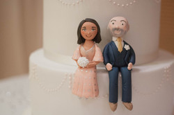 two tier vegan wedding cake bride and groom toppers
