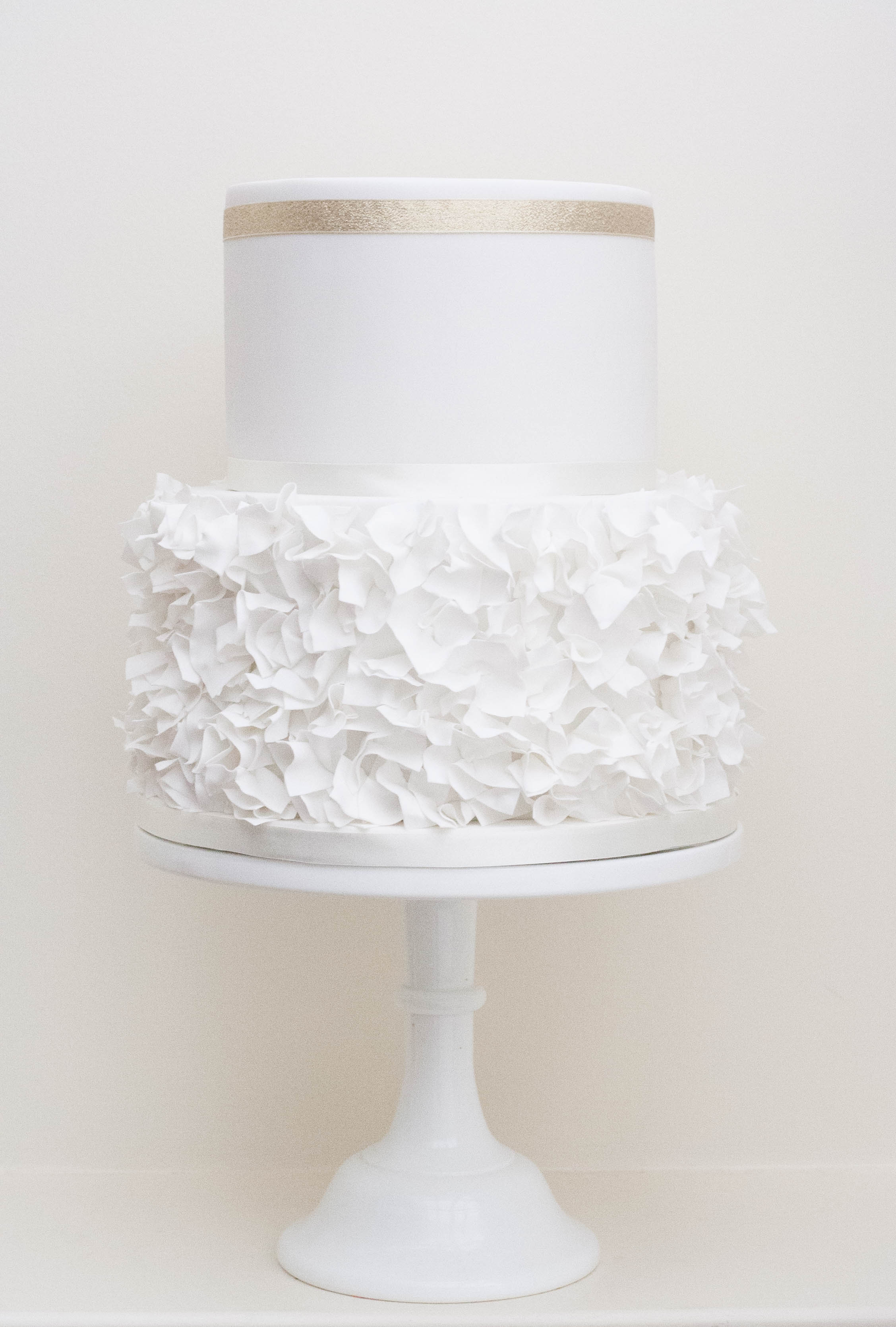 two tier sugar ruffles wedding cake vegan
