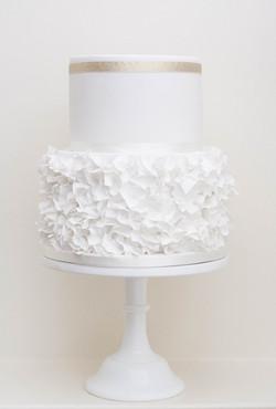 two tier sugar ruffles wedding cake vegan