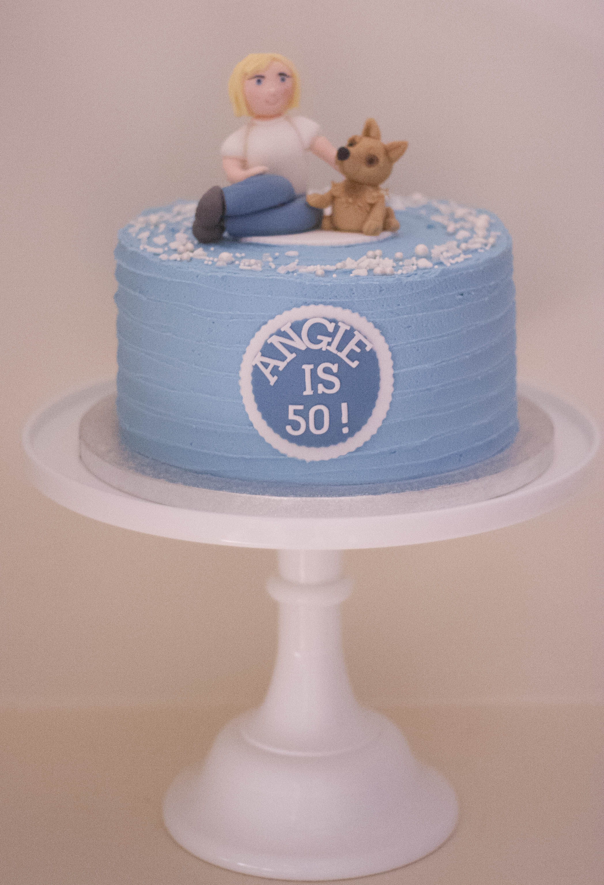 frosted vegan cake mum and dog
