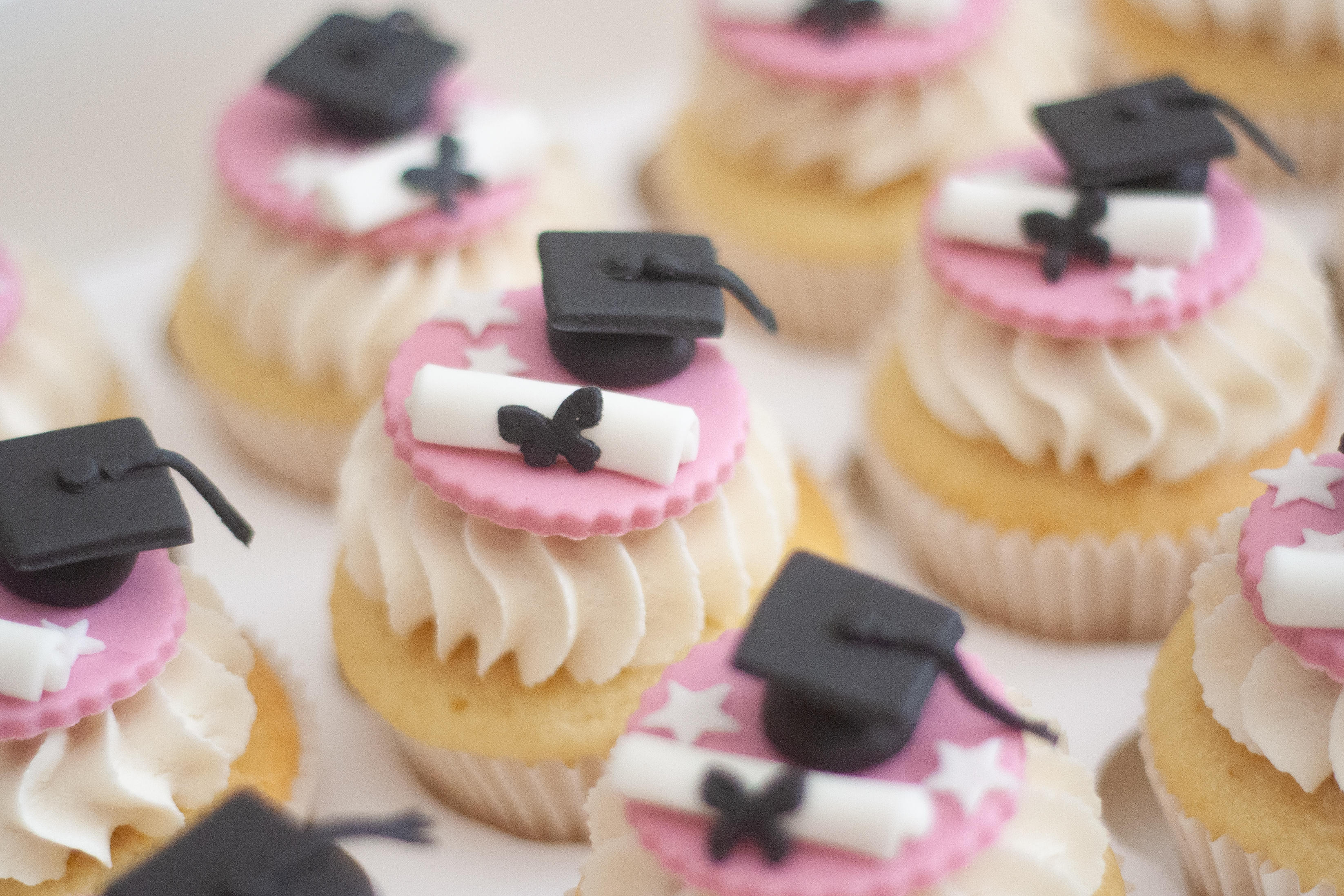 pink graduation cupcakes bow stars