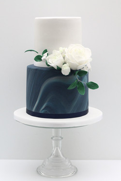midnight blue marbled wedding cake white roses