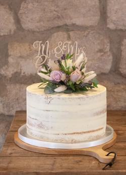 semi naked one tier wedding cake