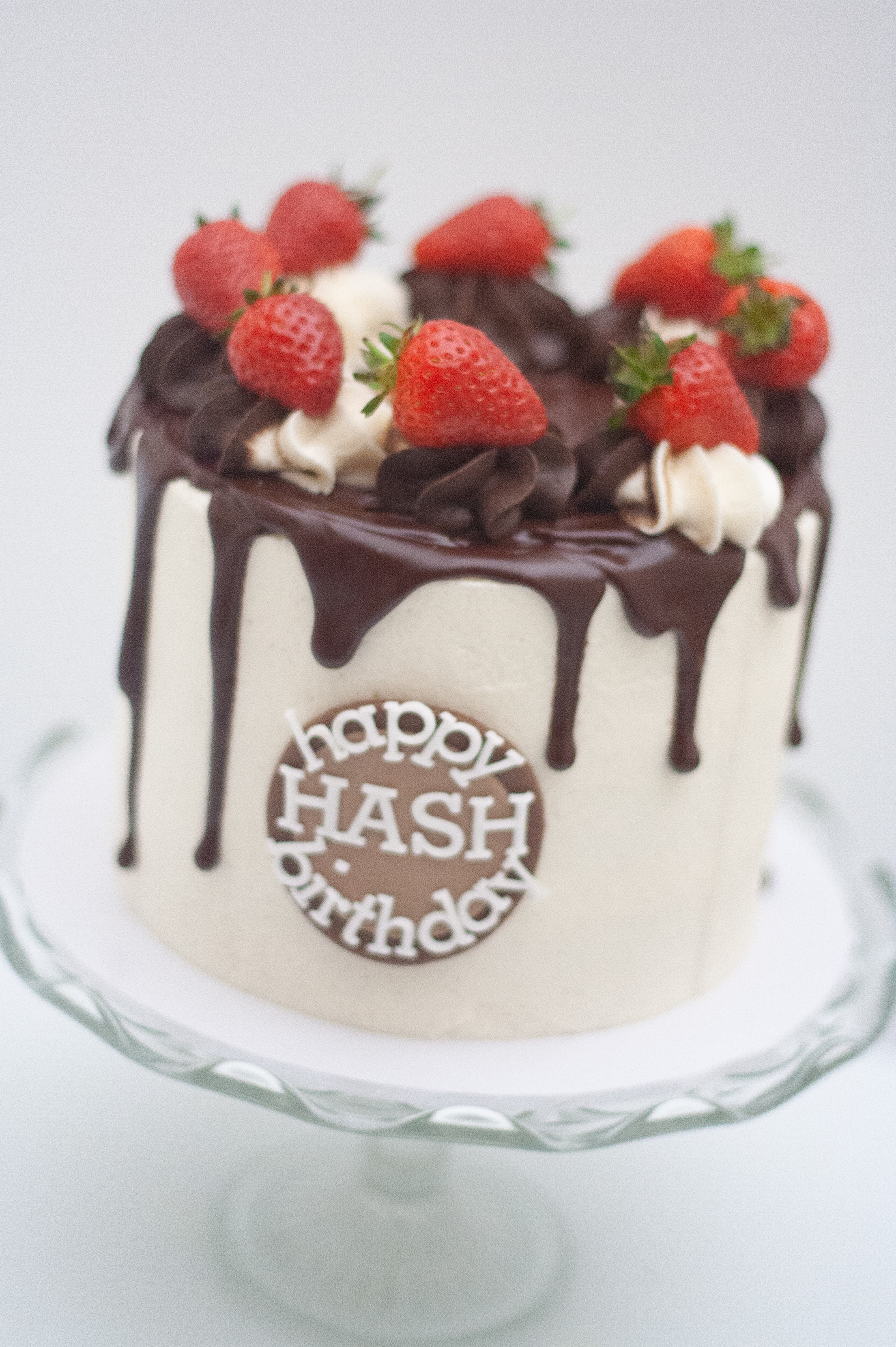 choc drip strawberry frosted cake