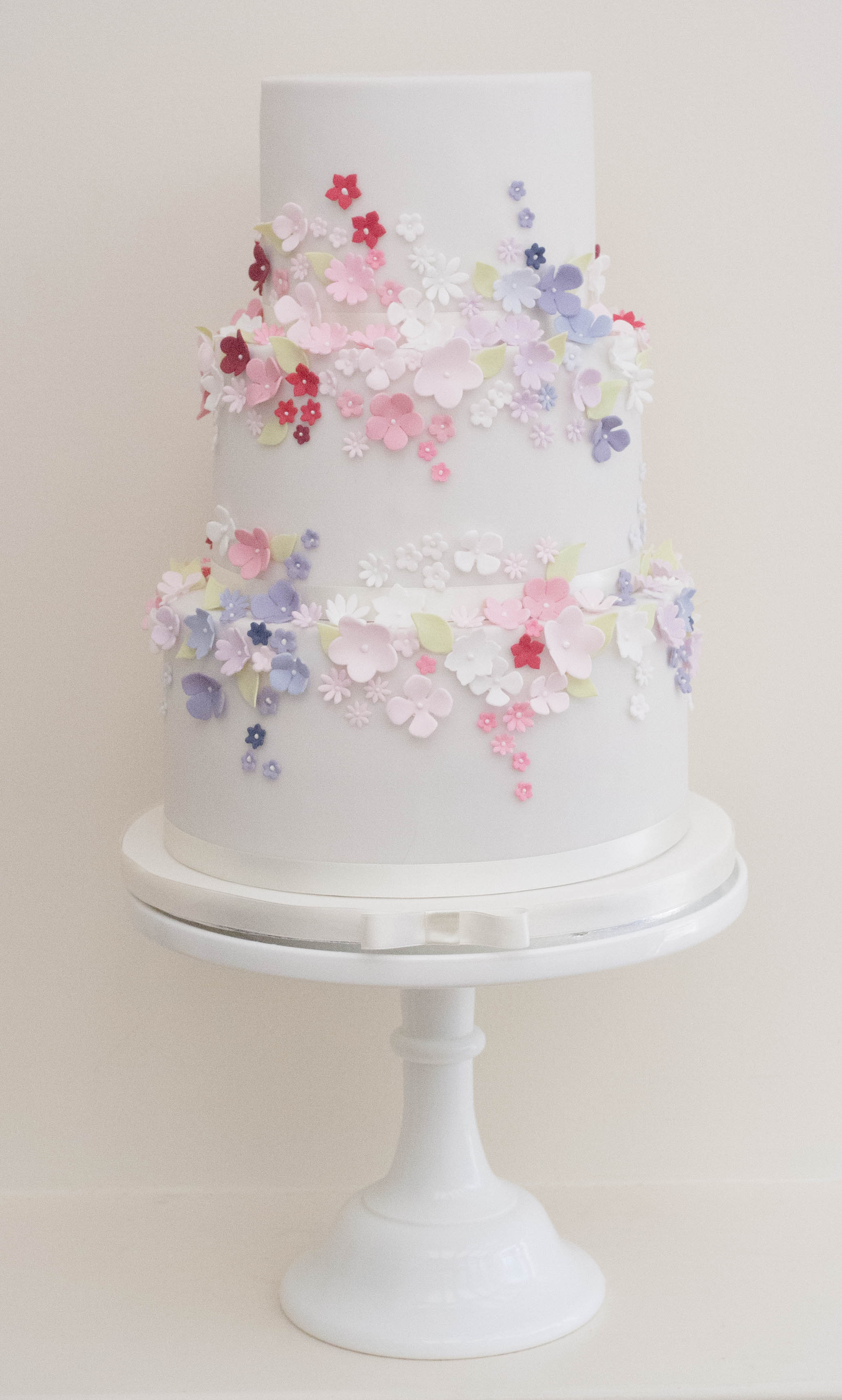 three tier vegan wedding cake pink purpl