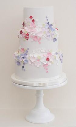 three tier vegan wedding cake pink purpl