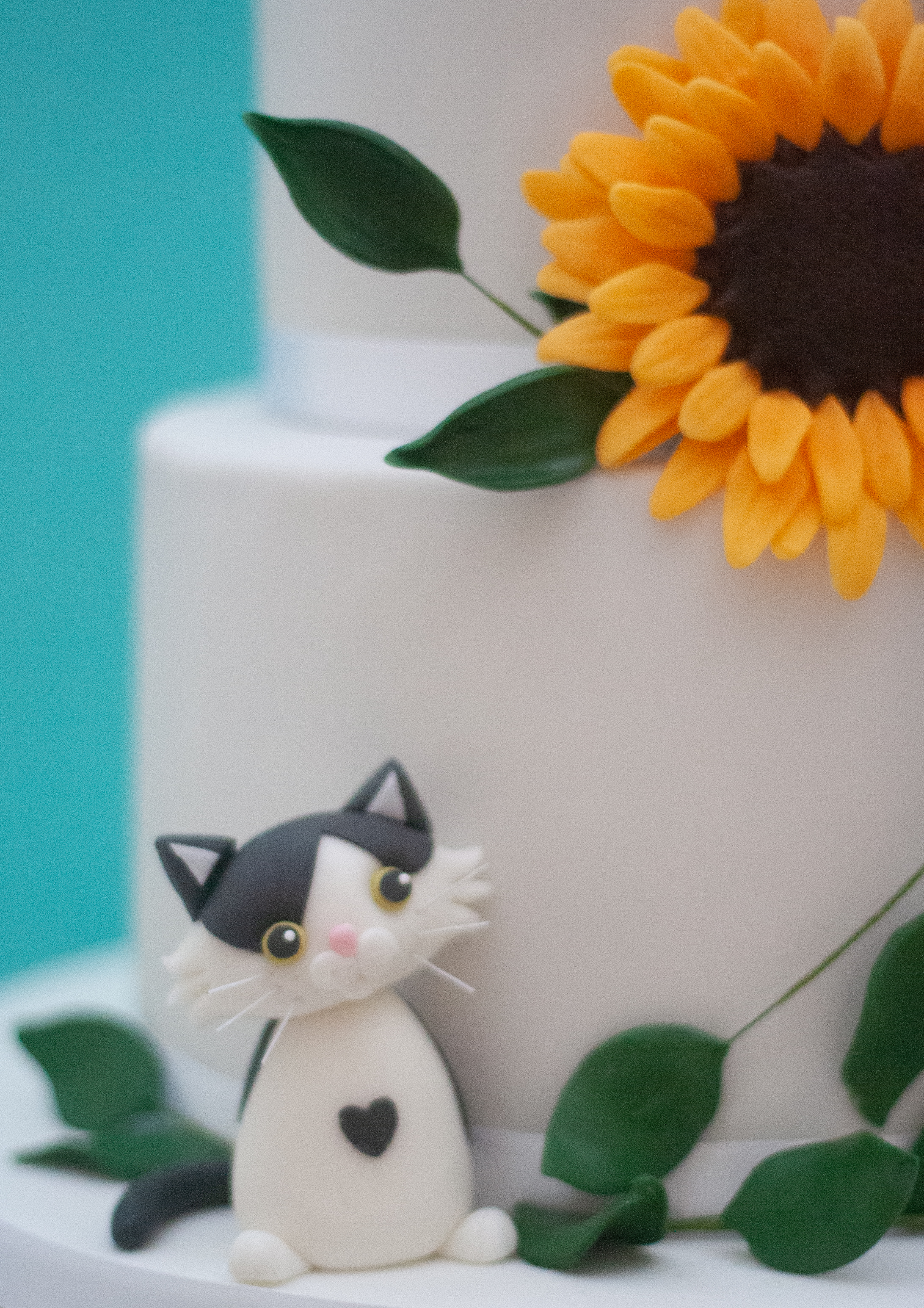 two tier wedding cake sunflower cat foli