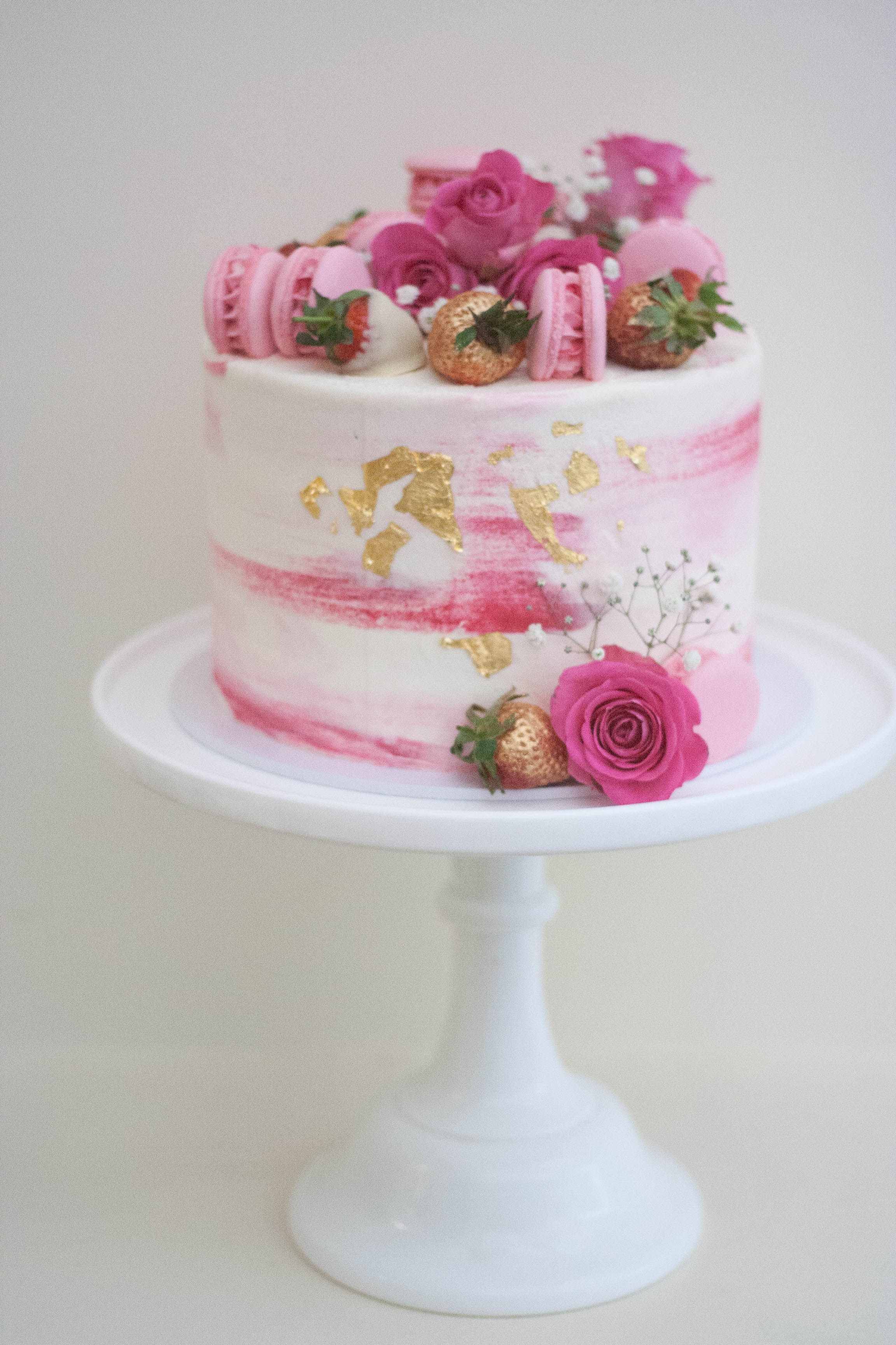 pink watercolour vegan cake with roses a