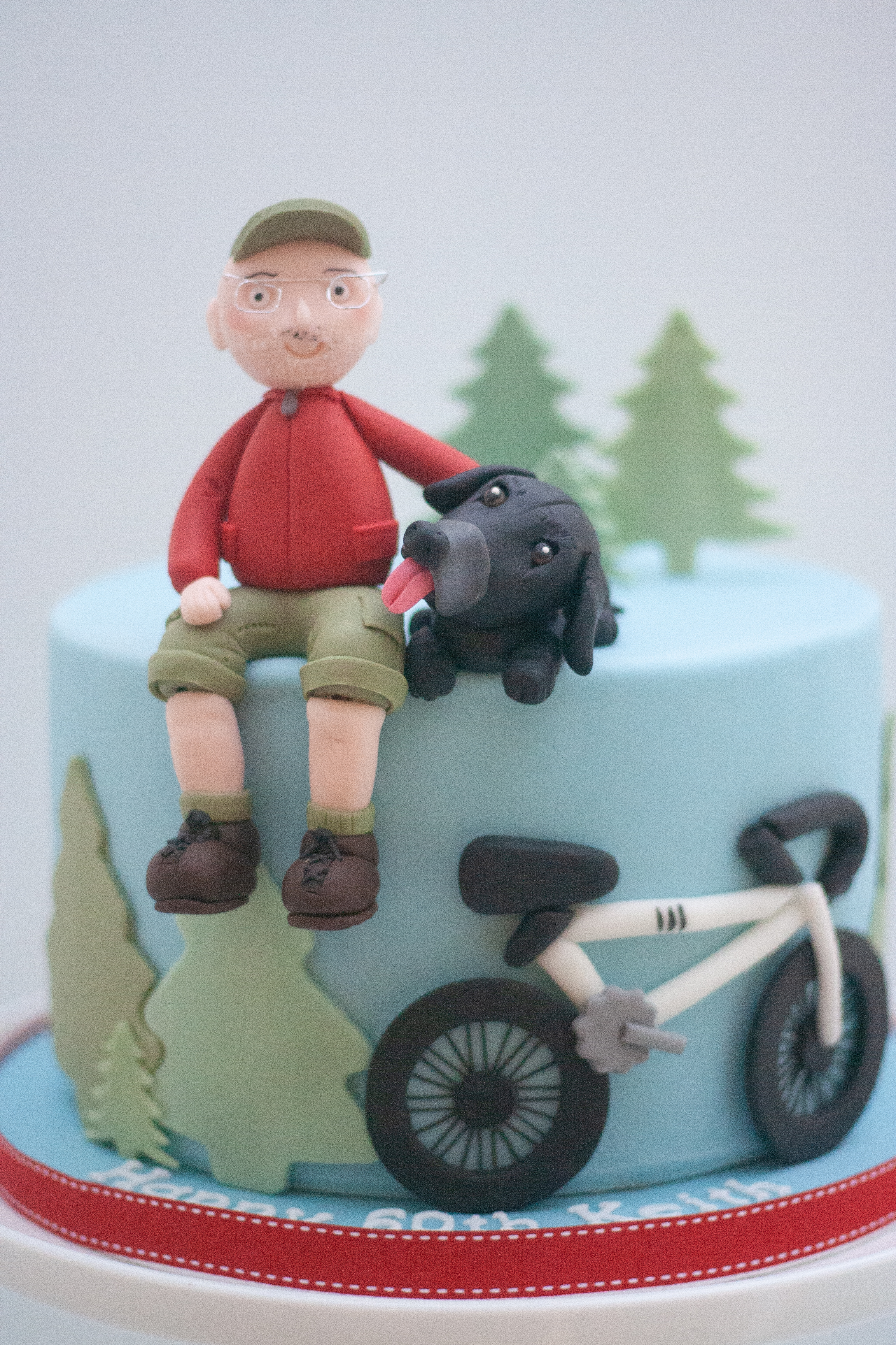 man dog bike cake